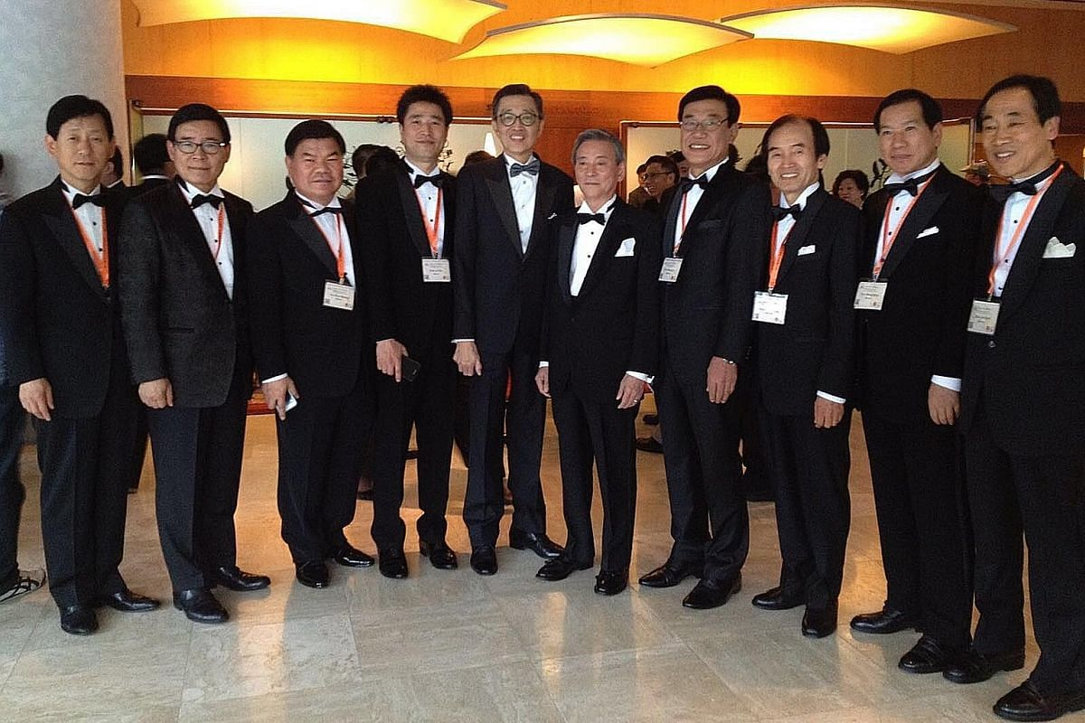 My life so far: Mr Thomas Wong (fifth from left), president of the Singapore Master Tailor Association, with top Korean tailors at a regional conference.