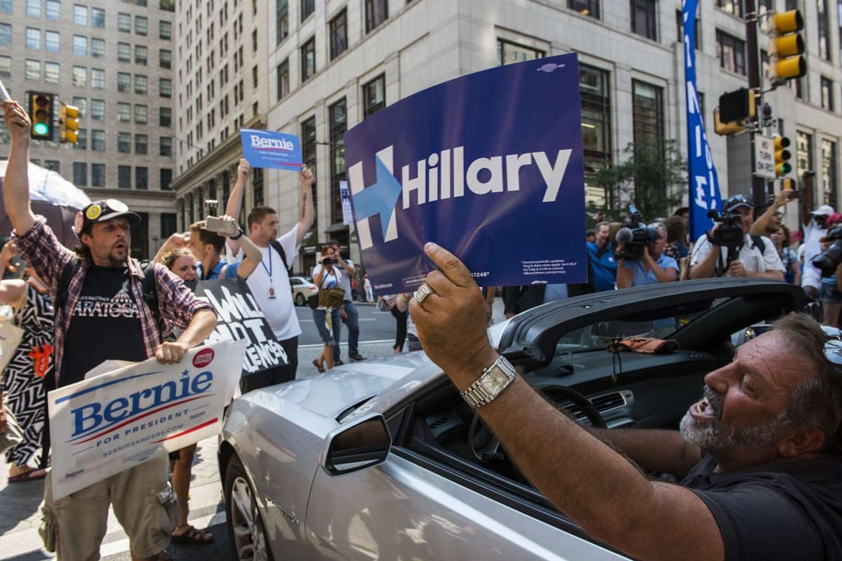 A Hillary Clinton supporter yells at pro-Bernie Sanders protesters gathered outside City Hall in Philadelphia on July 25, 2016. PHOTO: THE WASHINGTON POST