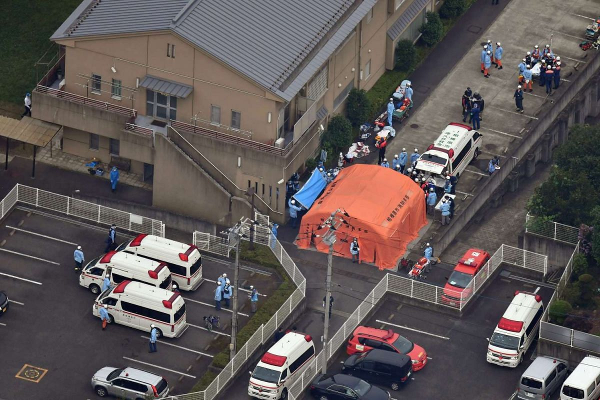 An aerial view shows emergency members at the Tsukui Yamayuri Garden, a residential care facility for disabled people in Sagamihara, Kanagawa Prefecture, about 40 km west of Tokyo, Japan, July 26, 2016. A man stabbed residents at the facility with a