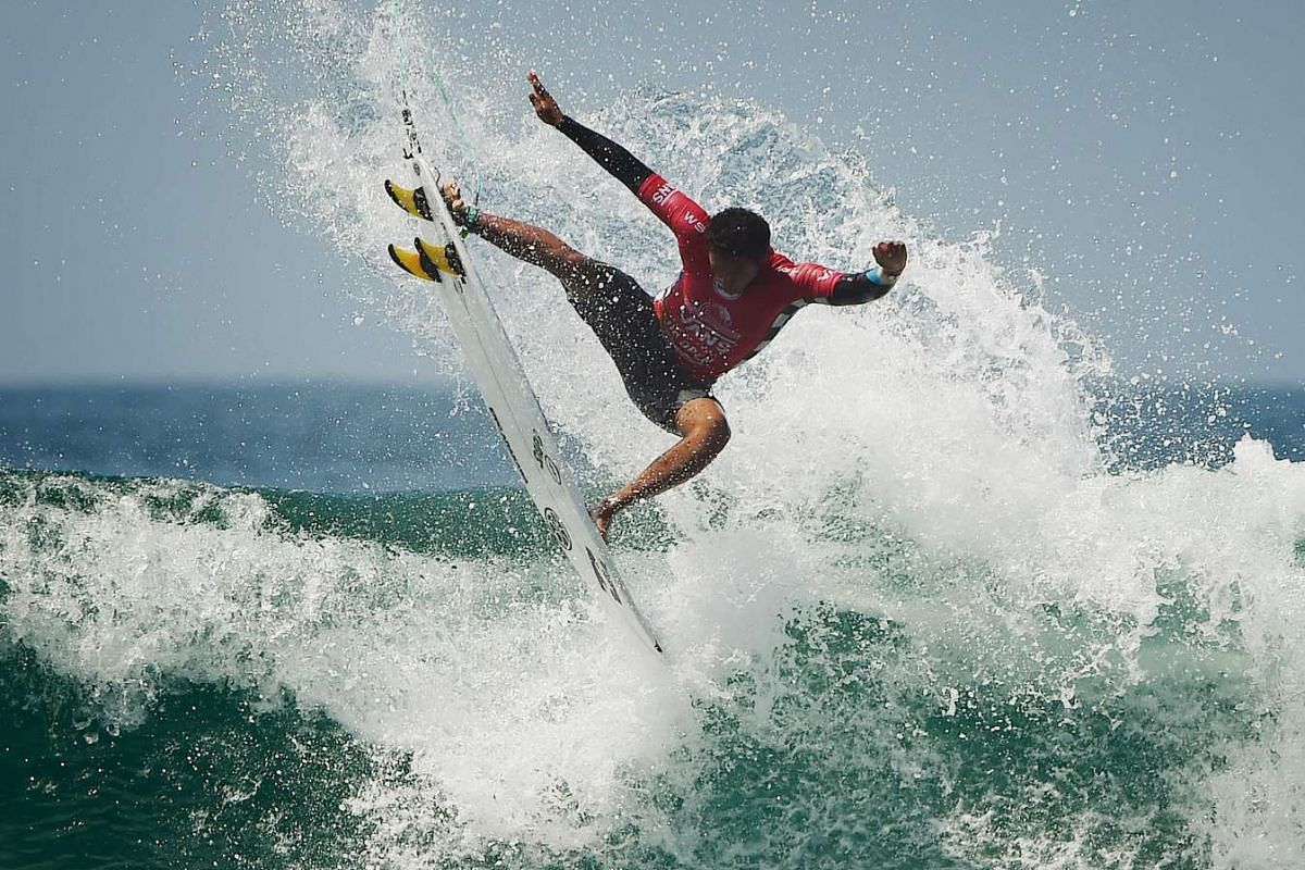 Joshua Moniz of Hawaii gets air in his men's heat during the first round of the US Open of Surfing at Huntington Beach, California on July 25, 2016. PHOTO: AFP
