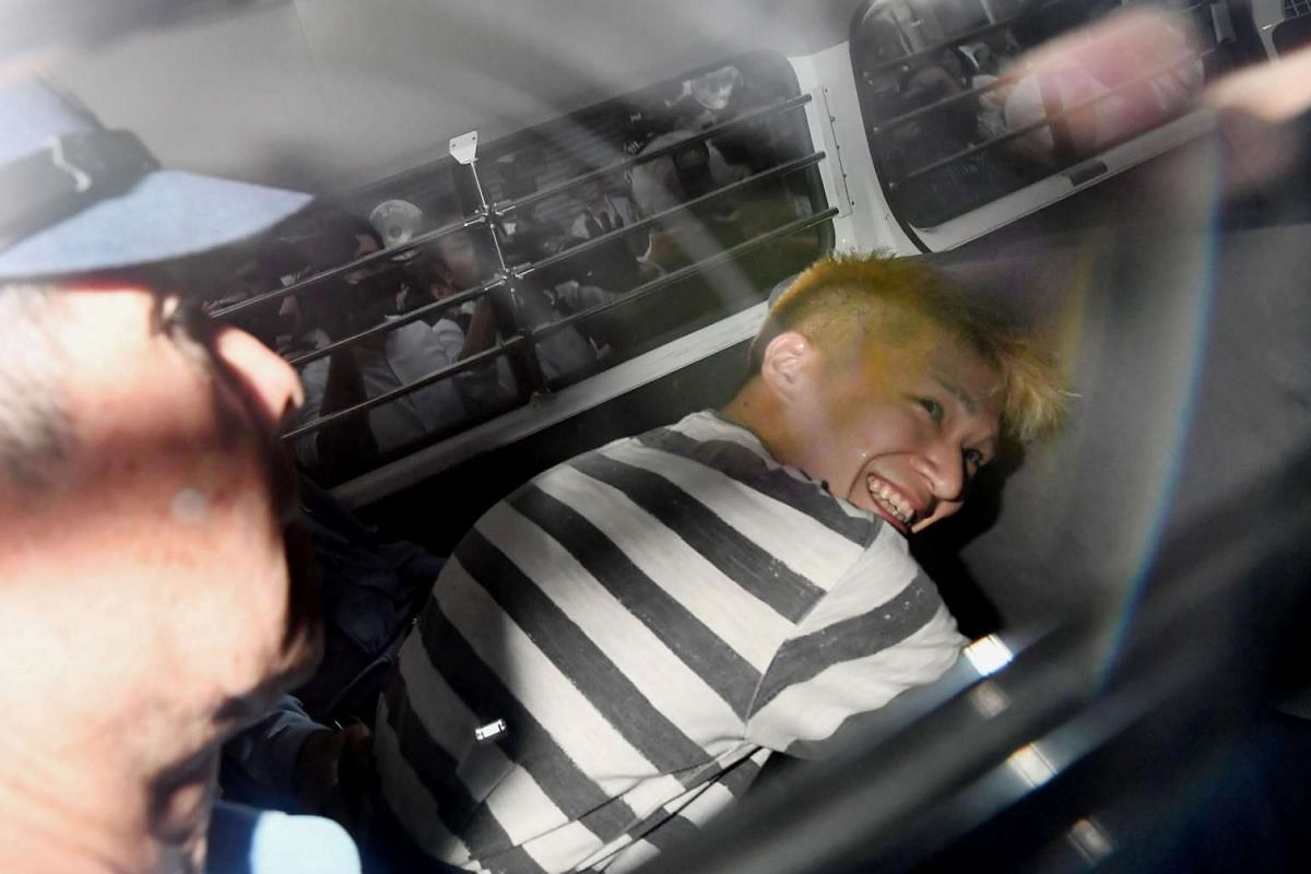 Satoshi Uematsu, suspected of a deadly attack at a facility for the disabled, is seen inside a police car as he is taken to prosecutors, at Tsukui police station in Sagamihara, Kanagawa prefecture, Japan, in this photo taken by Kyodo July 27, 2016. P