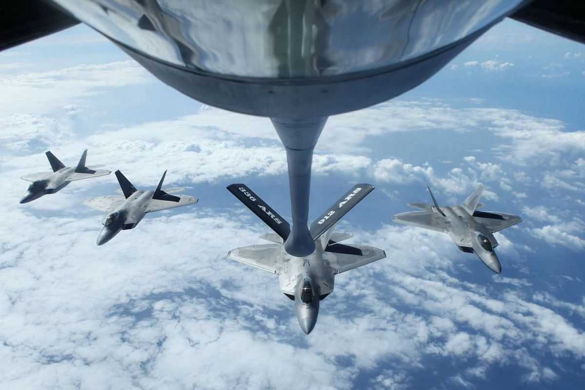Four F22 Raptors fly in formation after a mid-air refueling exercise with a KC-135R Stratotanker as they participate in the multi-national military exercise RIMPAC in Honolulu, Hawaii, July 26, 2016. PHOTO: REUTERS
