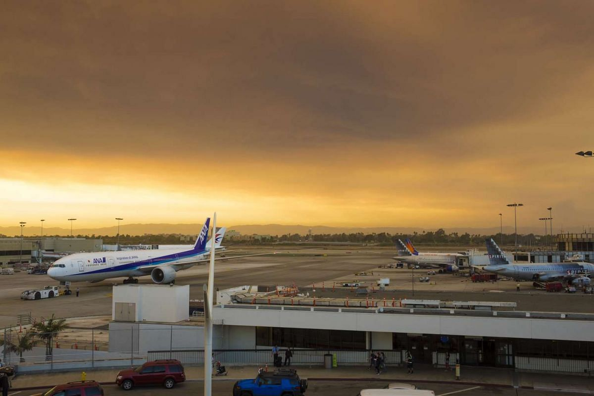 A cloud of smoke from the Santa Clarita fire is seen over Los Angeles International Airport, in Los Angeles, California on July 23.