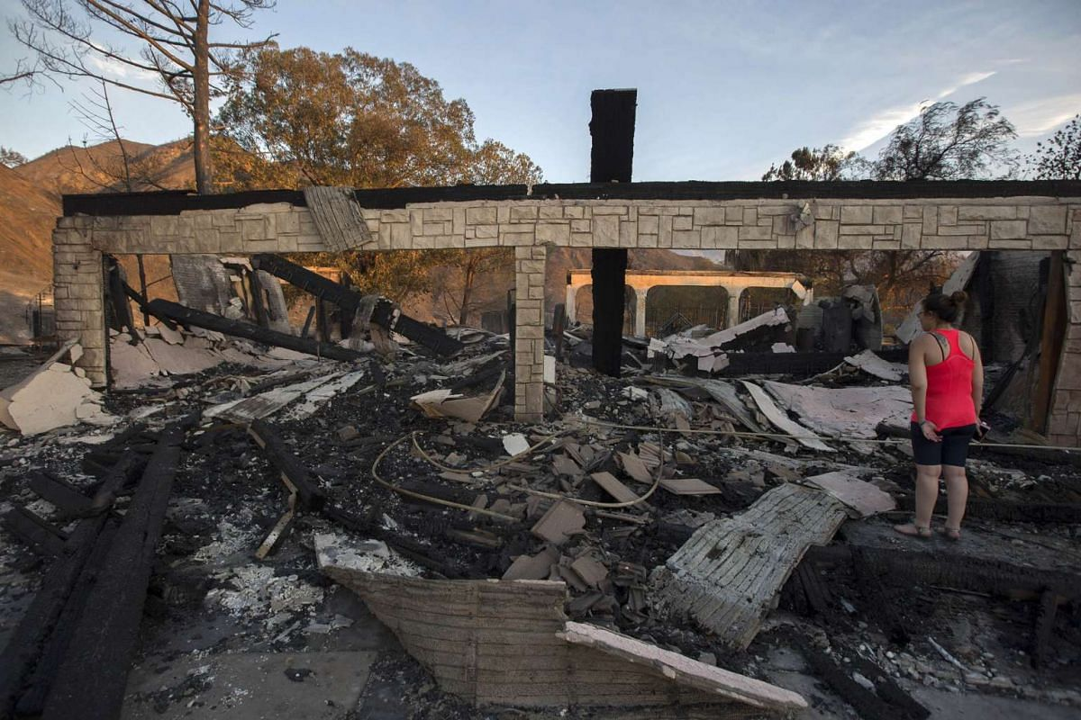 Residents and family members return to a home that was destroyed in the Sand Fire on July 25, 2016 in Santa Clarita, California.