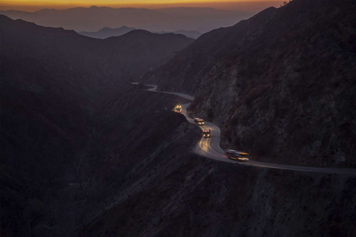 A convoy of firetrucks drives through Bear Canyon after it was burned bare by the Sand Fire on July 25, 2016 in Santa Clarita, California.