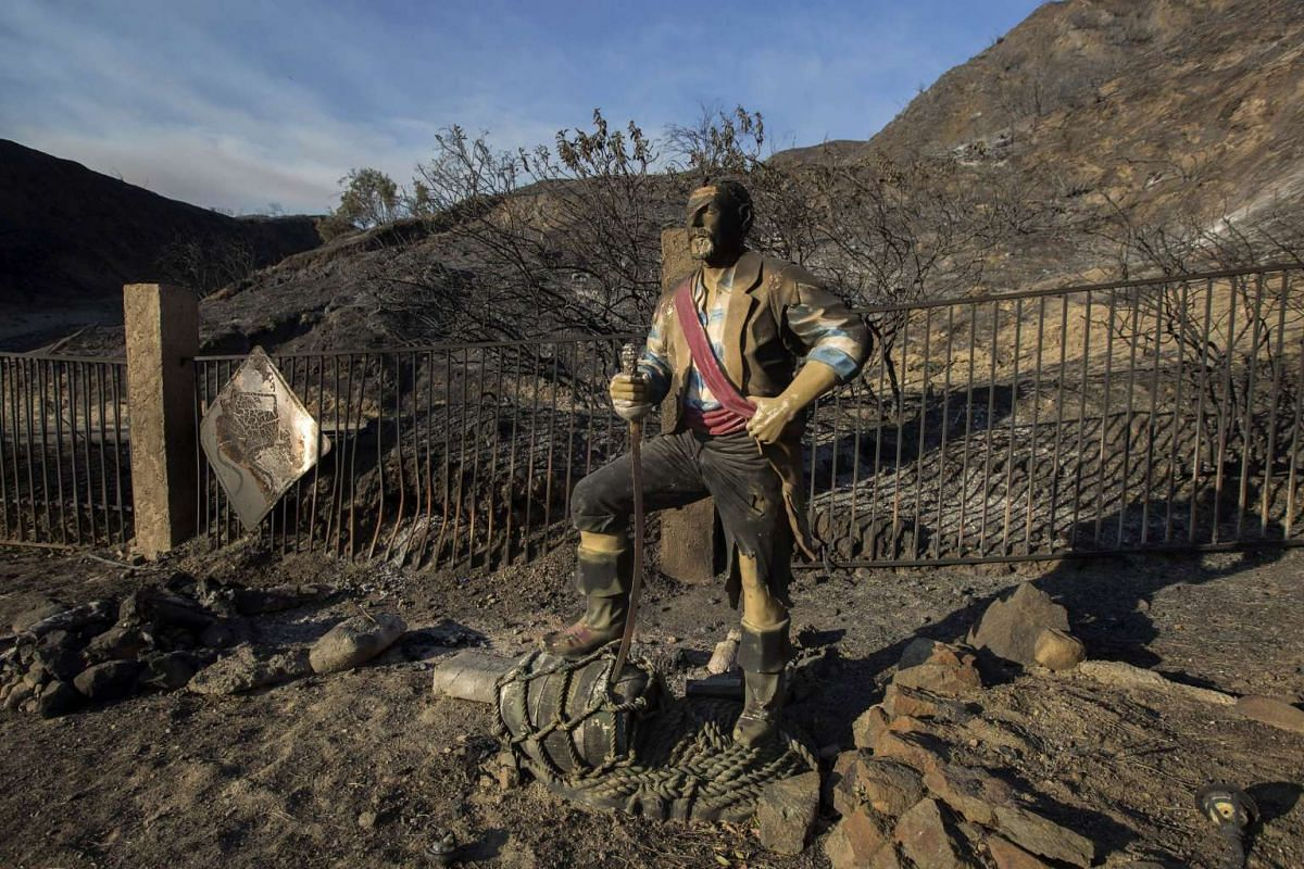 A burned pirate sculpture stands in a charred landscape at the Sand Fire on July 25, 2016 in Santa Clarita, California.