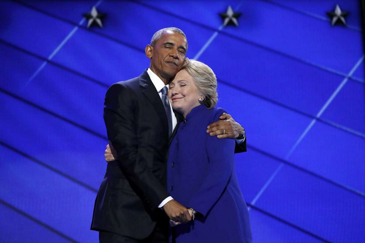 Democratic presidential nominee Hillary Clinton hugs U.S. President Barack Obama as she arrives onstage at the end of his speech on the third night of the 2016 Democratic National Convention in Philadelphia, Pennsylvania, U.S., July 27, 2016. PHOTO: