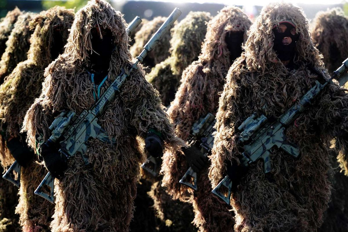 Members from an Indonesian sniper force of an anti-terror squad participate in a drill in Banda Aceh on July 27, 2016. PHOTO: AFP