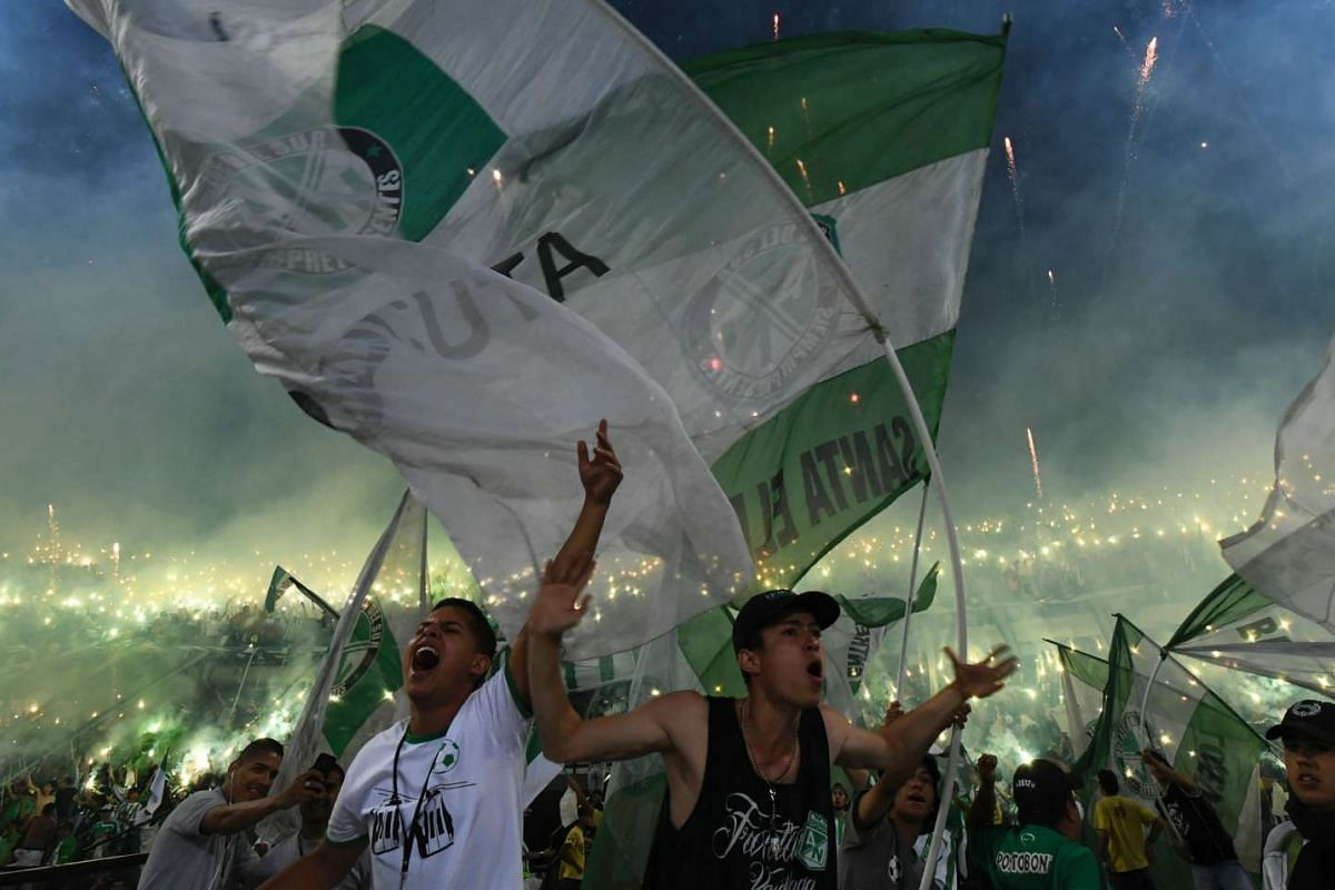 Colombian Atletico Nacional supporters cheer for their team before the start of the Libertadores Cup final match against Ecuadorean Independiente del Valle in Medellin, Colombia on July 27, 2016. PHOTO: AFP