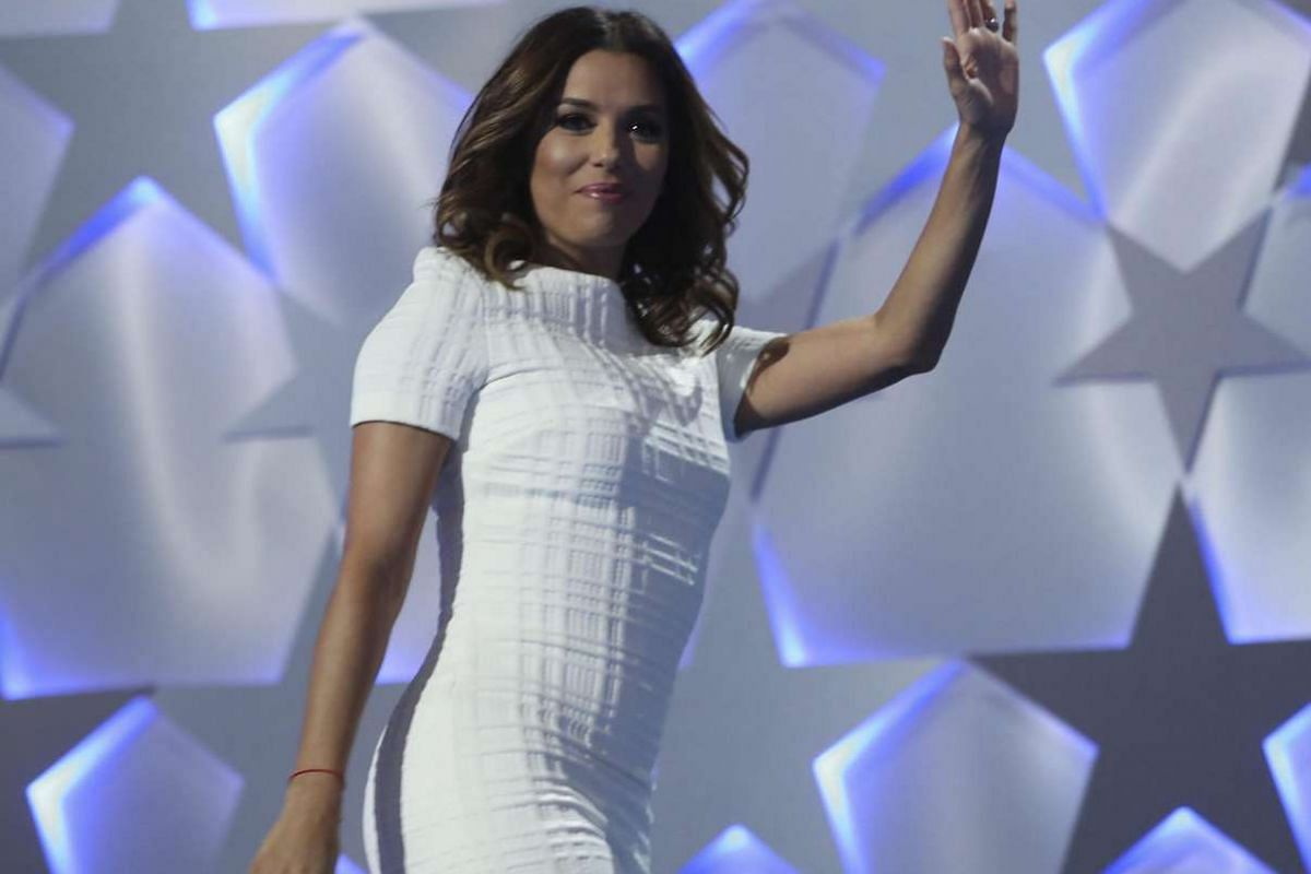 Actress/producer Eva Longoria waves to the crowd as she takes the stage on July 25.