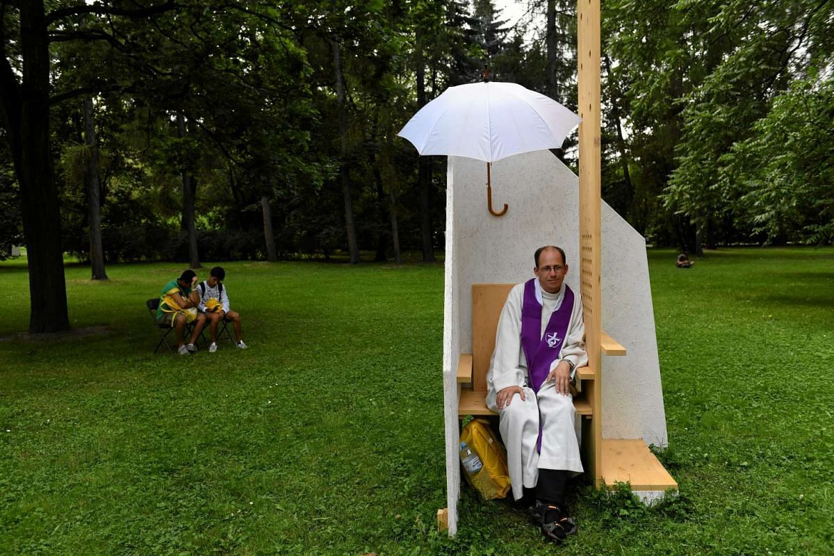 A priest waits for faithful in a confessional before a mass led by Pope Francis in Krakow, Poland, on July 28, 2016.
