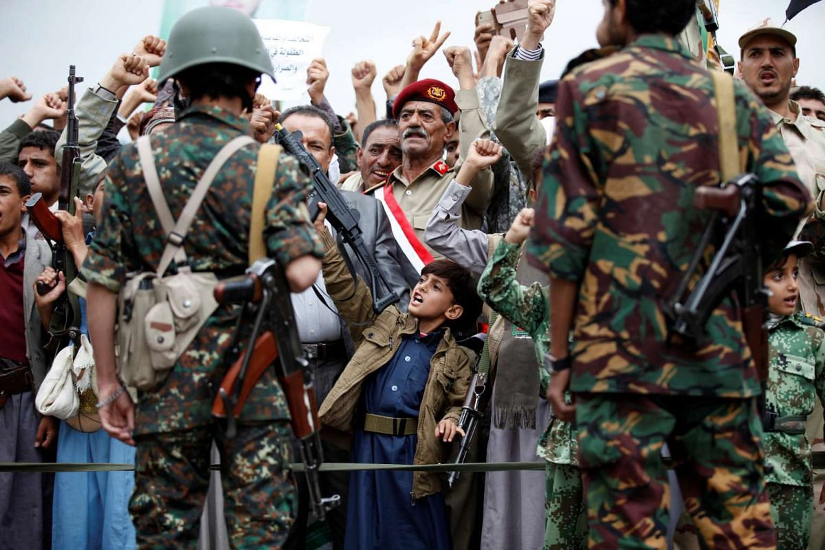 Supporters of the Houthi movement take part in a demonstration in Sanaa, Yemen, on July 28, 2016.