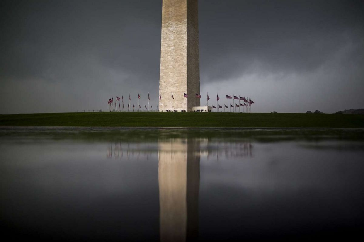 Skies darken near the Washington Monument as a series of late afternoon thunderstorms rumbled through Washington, DC, on July 28, 2016.