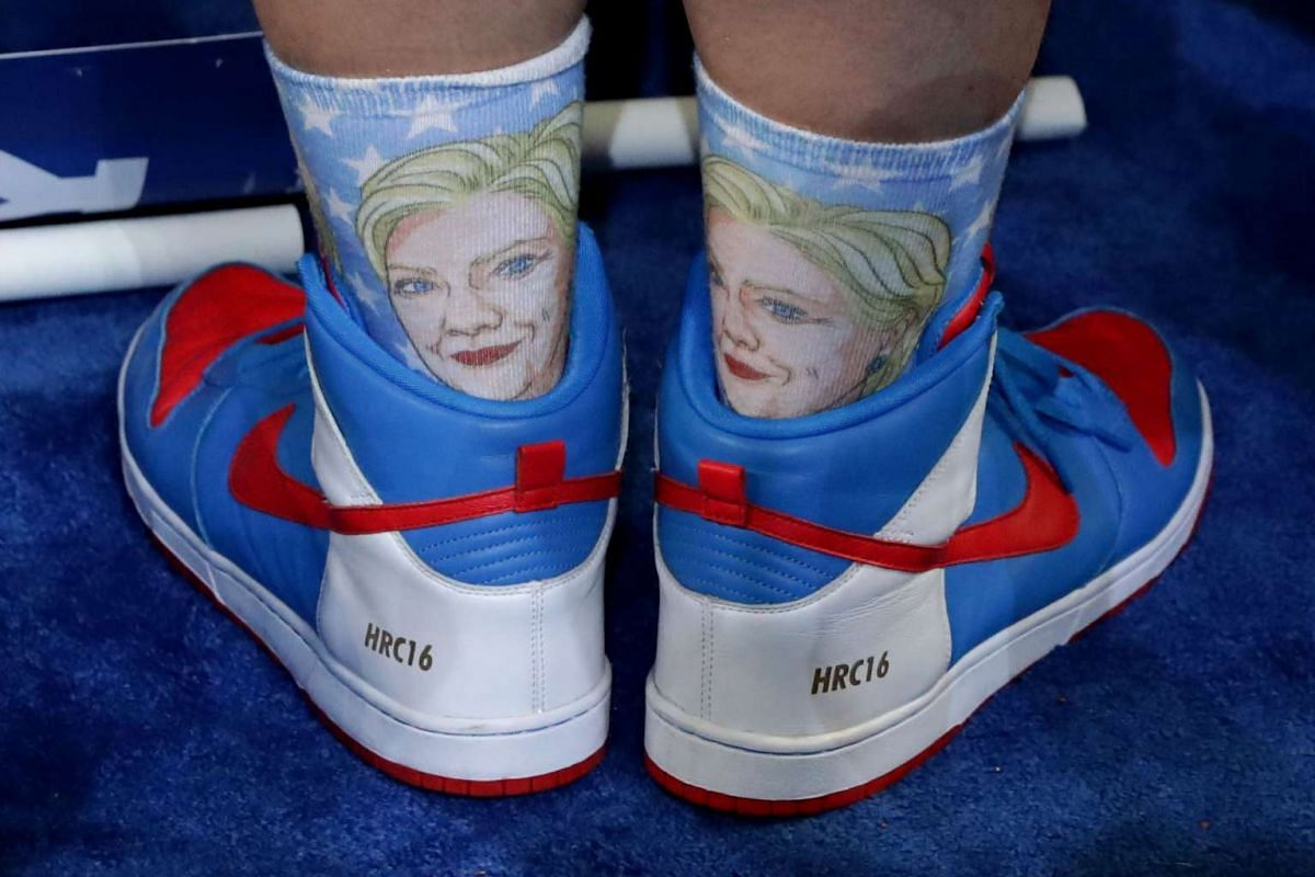 An attendee wears Hillary Clinton themed shoes and socks on the fourth day of the Democratic National Convention in Philadelphia, Pennsylvania, on July 28, 2016.