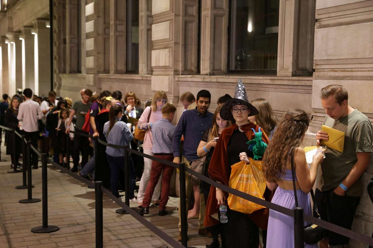 Queues stretch around the corner of Eagle Place off Piccadilly from outside Waterstones bookshop on Piccadilly in central London on July 30 ahead of the midnight party to celebrate the publication of Harry Potter and the Cursed Child Parts I and II s