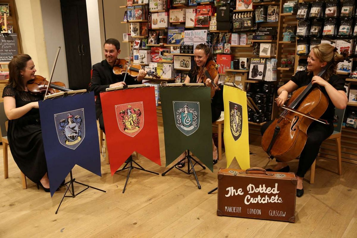 A string quartet plays at an event to mark the release of the Harry Potter and the Cursed Child Parts I and II script book at a bookstore in London, Britain, on July 30, 2016.