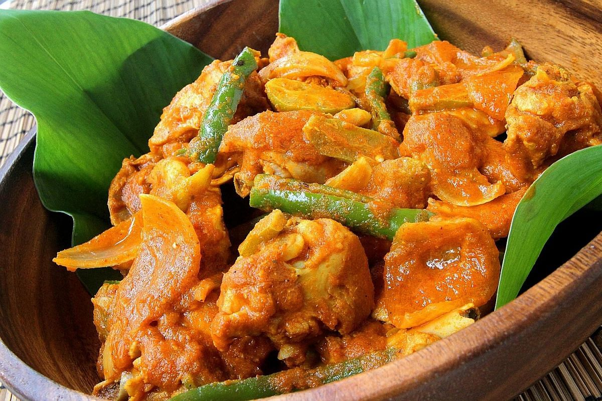 A spicy chicken with belimbing assam dish. The sour belimbing fruit used to be pickled and added to curries and soups or mashed into a chutney.