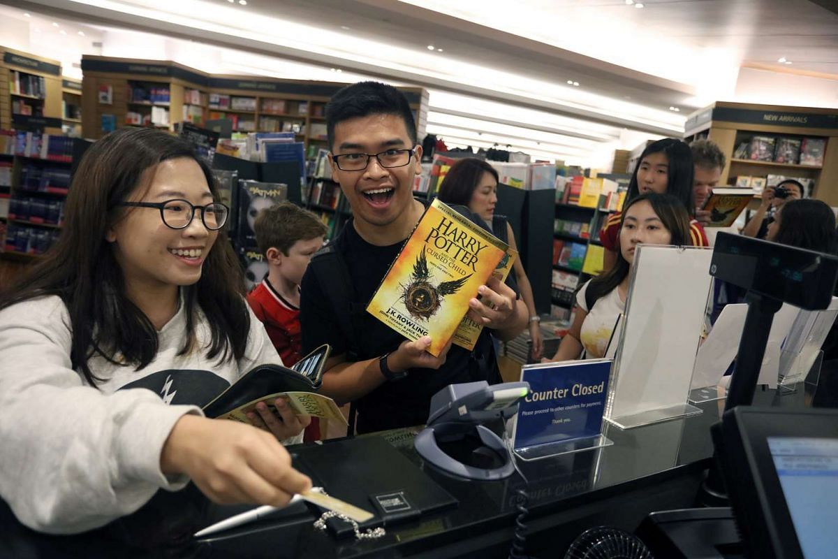 Harry Potter fans Samantha Chua, 24, and Jeremy Liu, 25, were first in line for the new book launch at Kinokuniya in Singapore. They queued up from 5am on July 31, 2016.