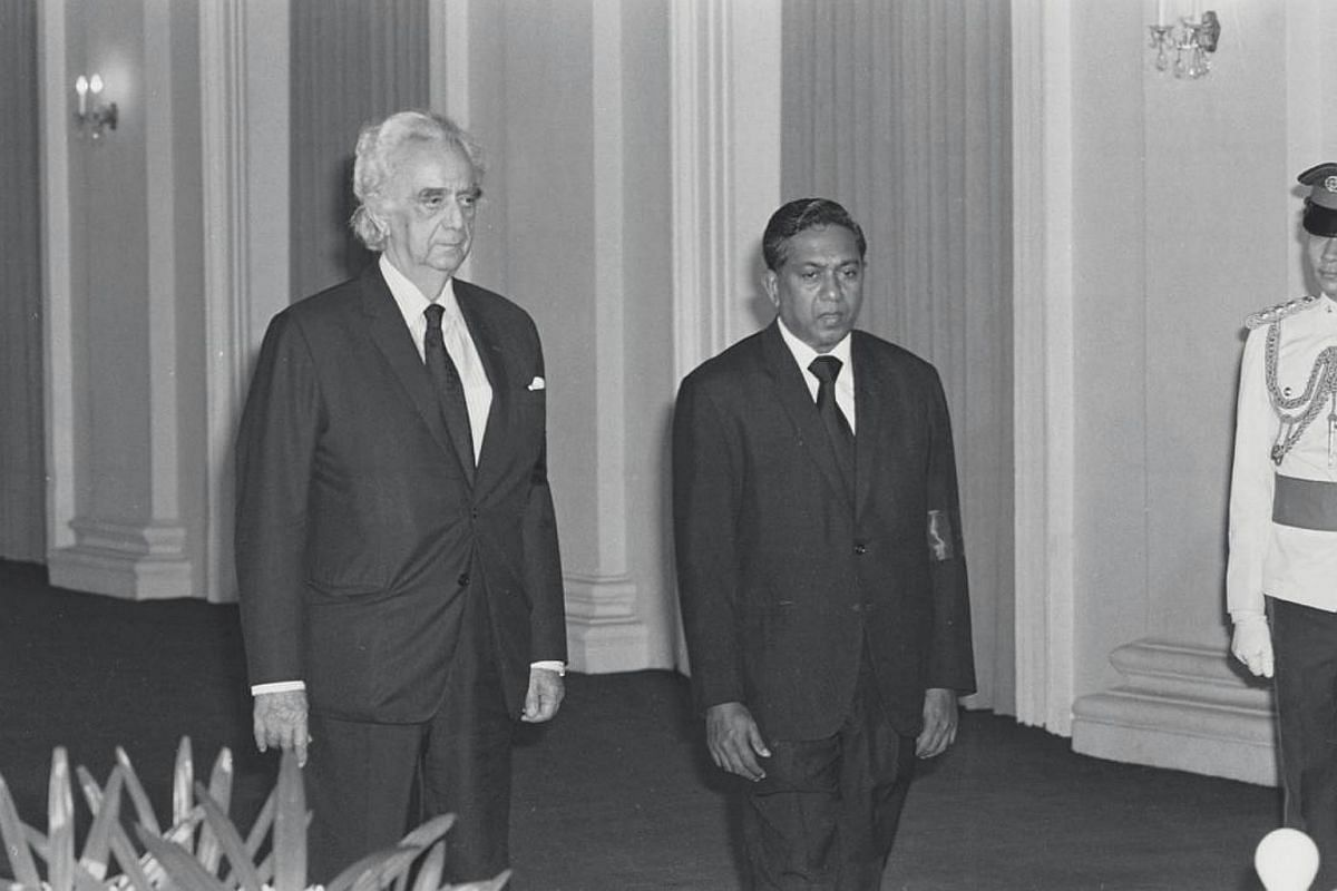 Mr David Marshall and Mr S R Nathan pay their last respects to late president Benjamin Sheares at the Istana in May 1981.