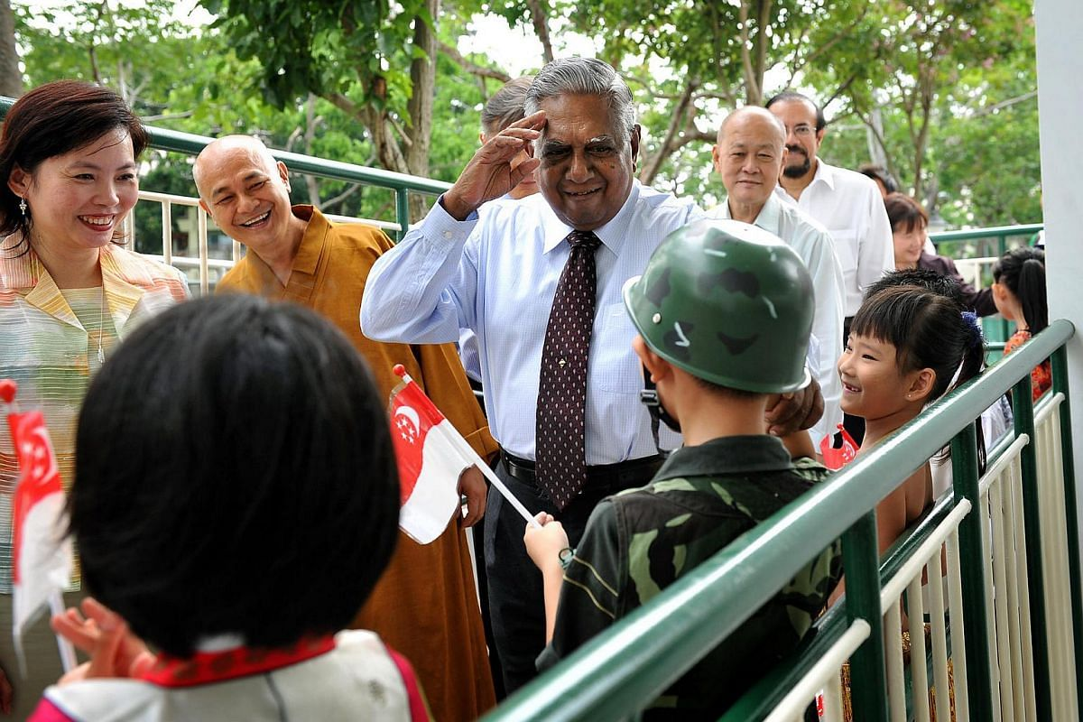 Mr S R Nathan salutes a Maha Bodhi School student in a soldier's uniform in August 2009.