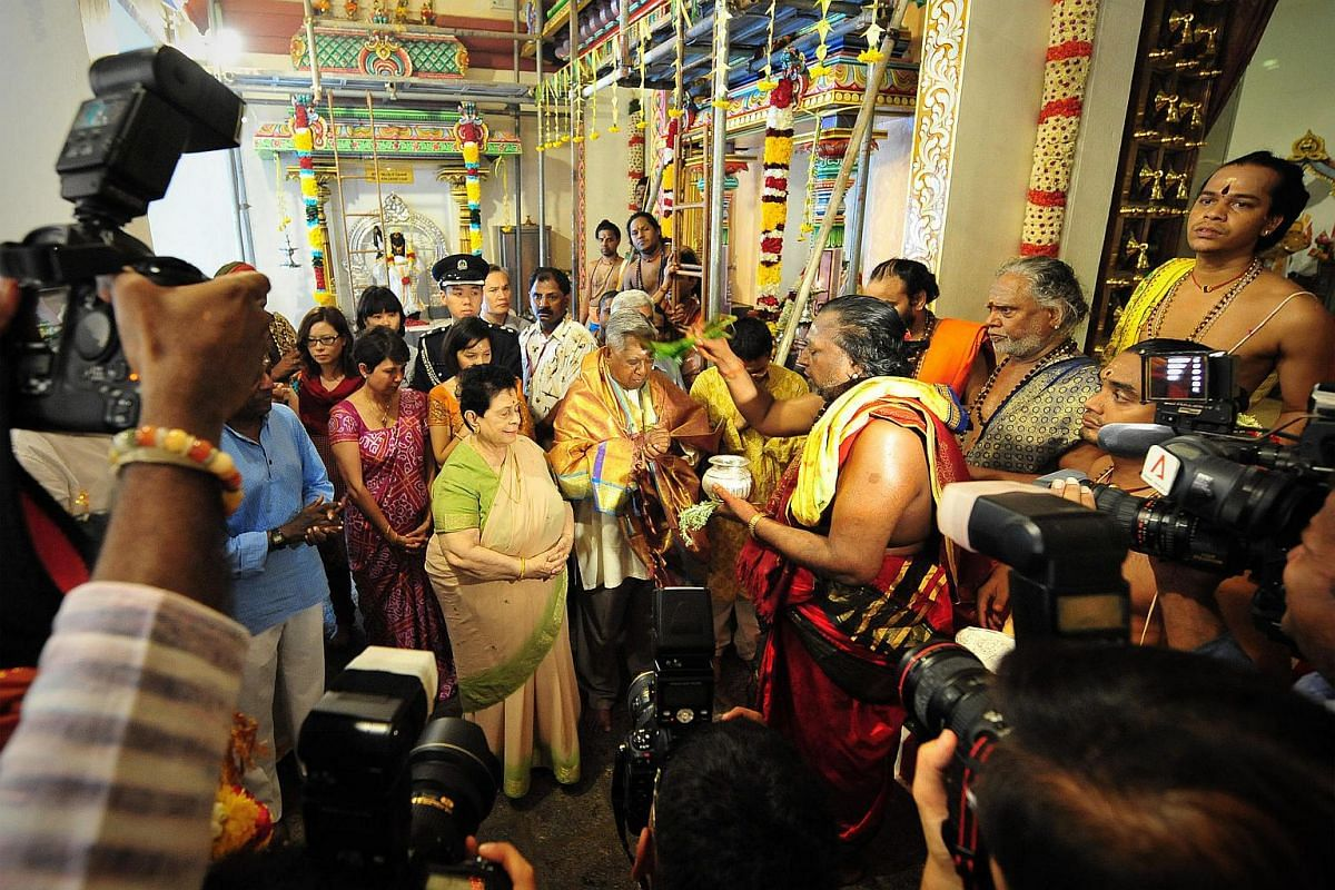Mr S R Nathan receiving blessings at the consecration ritual at Sri Mariamman Temple in April 2010.