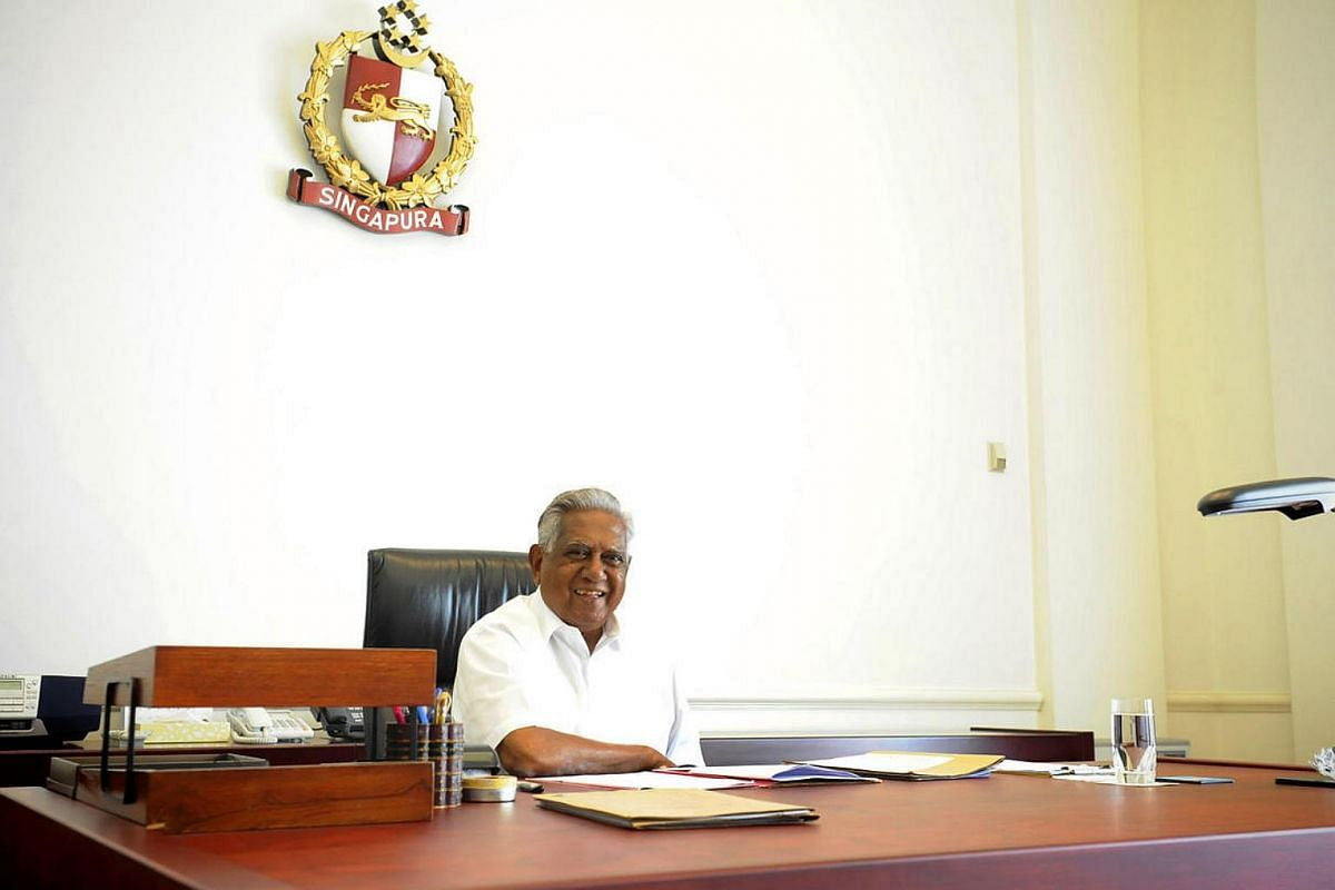 Mr Nathan at his desk on his last day in office on Aug 31, 2011. His personal items were already packed.