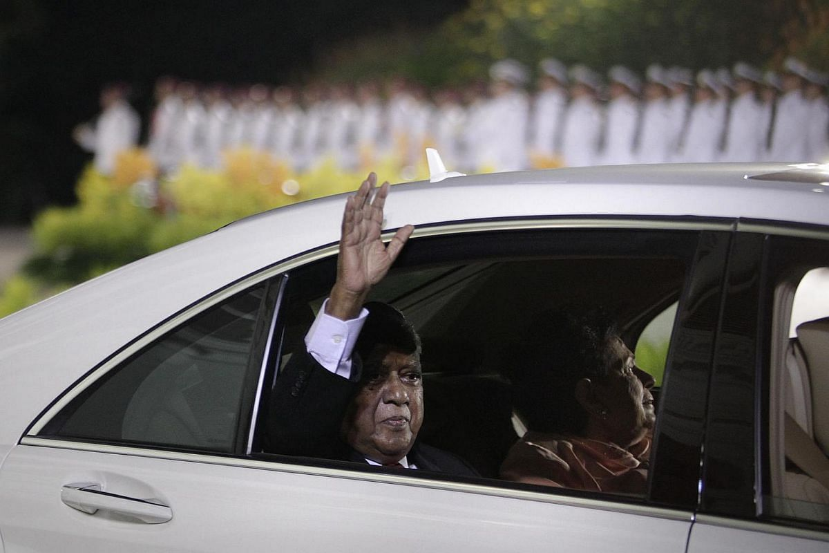 Mr Nathan waves his final goodbye to a cheering crowd as he and his wife leave the Istana after a farewell parade on Sept 1, 2011.