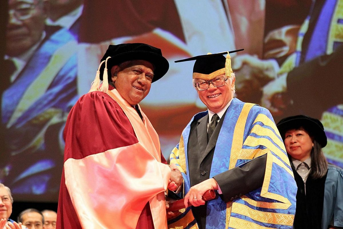 Mr Nathan receives his honorary doctor of letters from successor Tony Tan Keng Yam during the National University of Singapore's commencement ceremony on July 5, 2012.