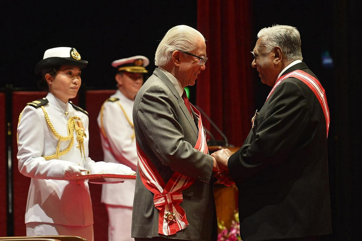 Mr Nathan being conferred the Order of Temasek (First Class) by Dr Tan in 2013.