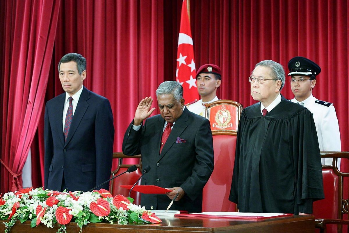 Mr S R Nathan with Prime Minister Lee Hsien Loong as he is sworn in for his second term in office on Sept 1, 2005.