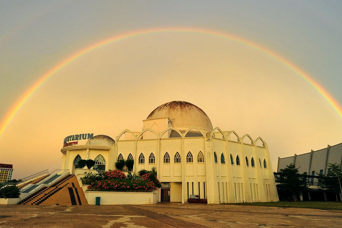 A rainbow over the Malacca Planetarium Adventure Science Centre, a three-storey, Islamic-inspired complex in Ayer Keroh which houses multiple exhibition areas and Malaysia's largest dome theatre for movie screenings.