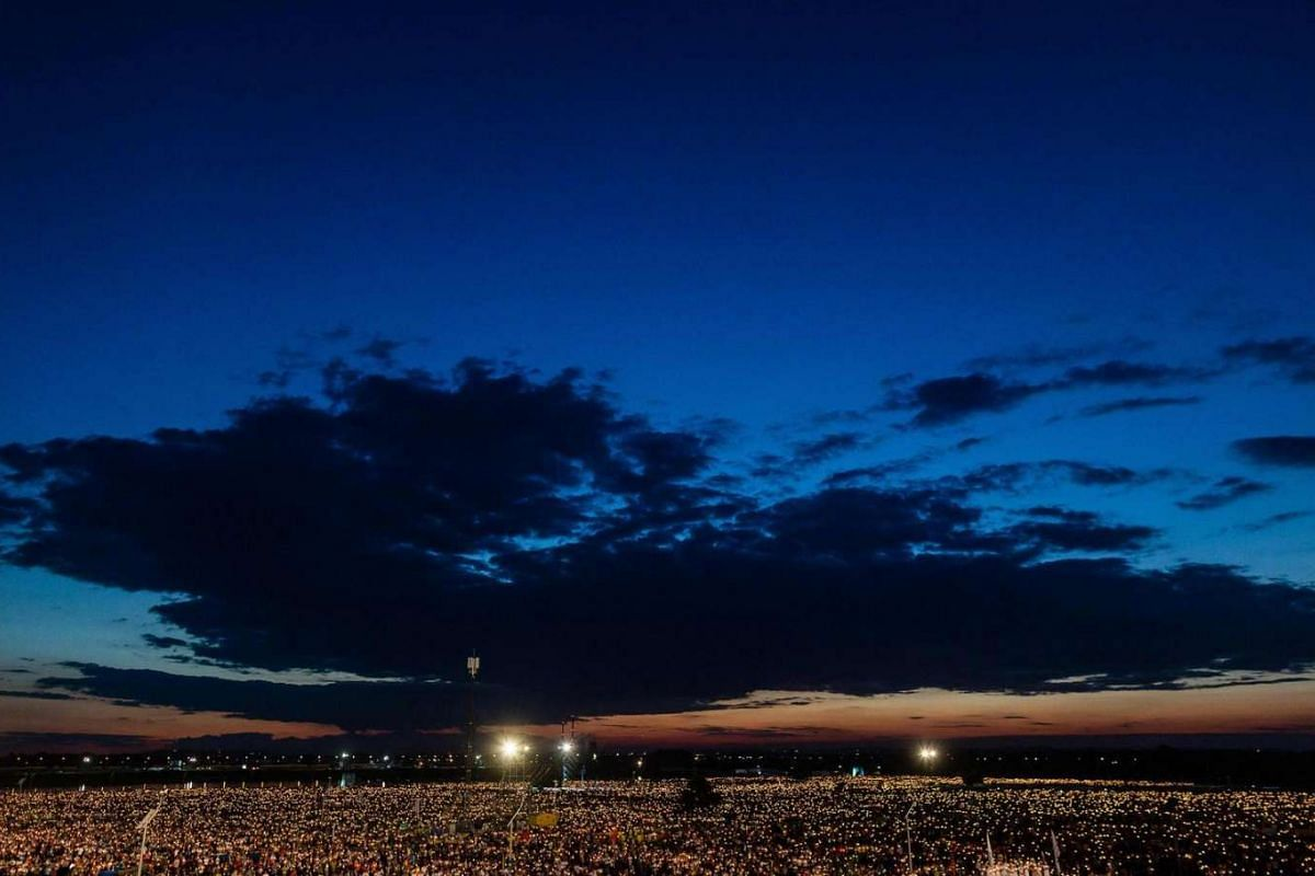 Thousands of pilgrims light candles as they take part in a night vigil held by Pope Francis at Campus Misericordiae on July 30 in Brzegi as part of the World Youth Days.