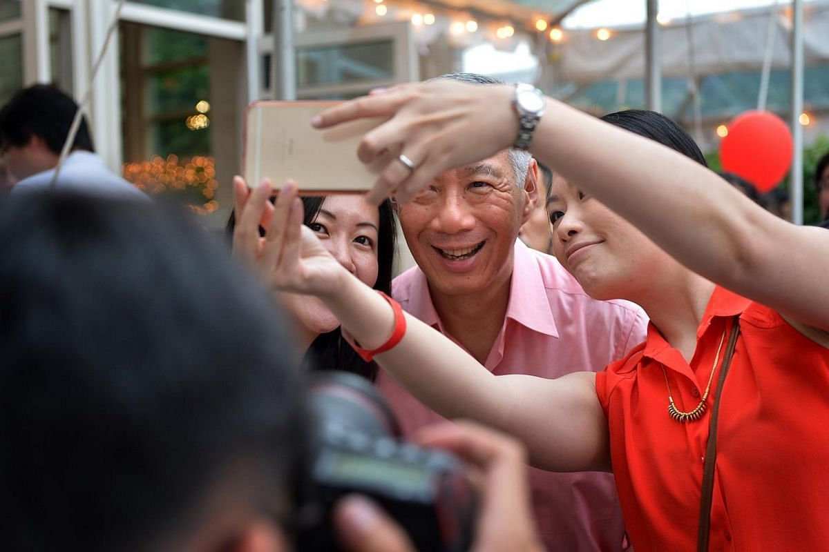 PM Lee takes a photo with fellow Singaporeans at the National Day celebrations in the Singapore embassy in Washington, DC, on July 31.