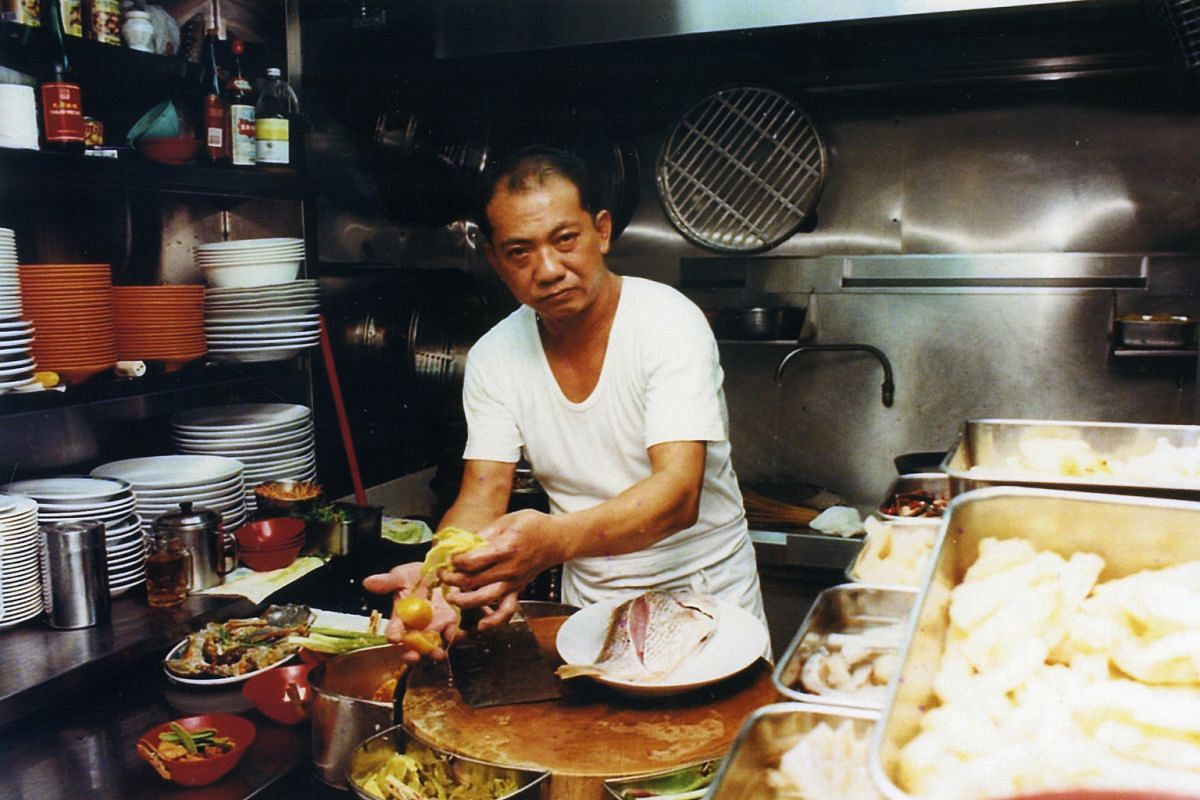My life so far: Ms Goh Chiew Buay's father, Mr Goh Leng Chia, at their current outlet in Jalan Bukit Merah in 1997.