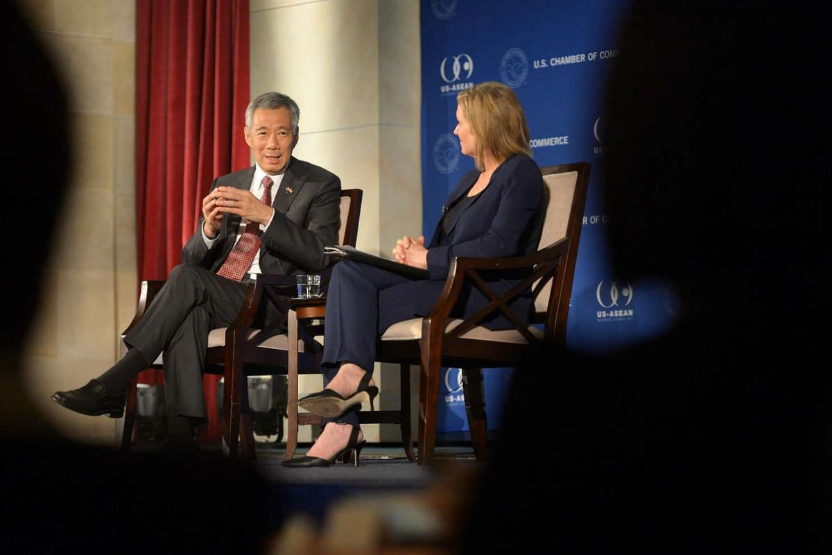 Singapore PM Lee Hsien Loong at US Chamber of Commerce Hall of Flags in Washington, DC on August 1, where he addressed invited guests and also responded to questions at a forum moderated by Ambassador Susan Schwab (right).
