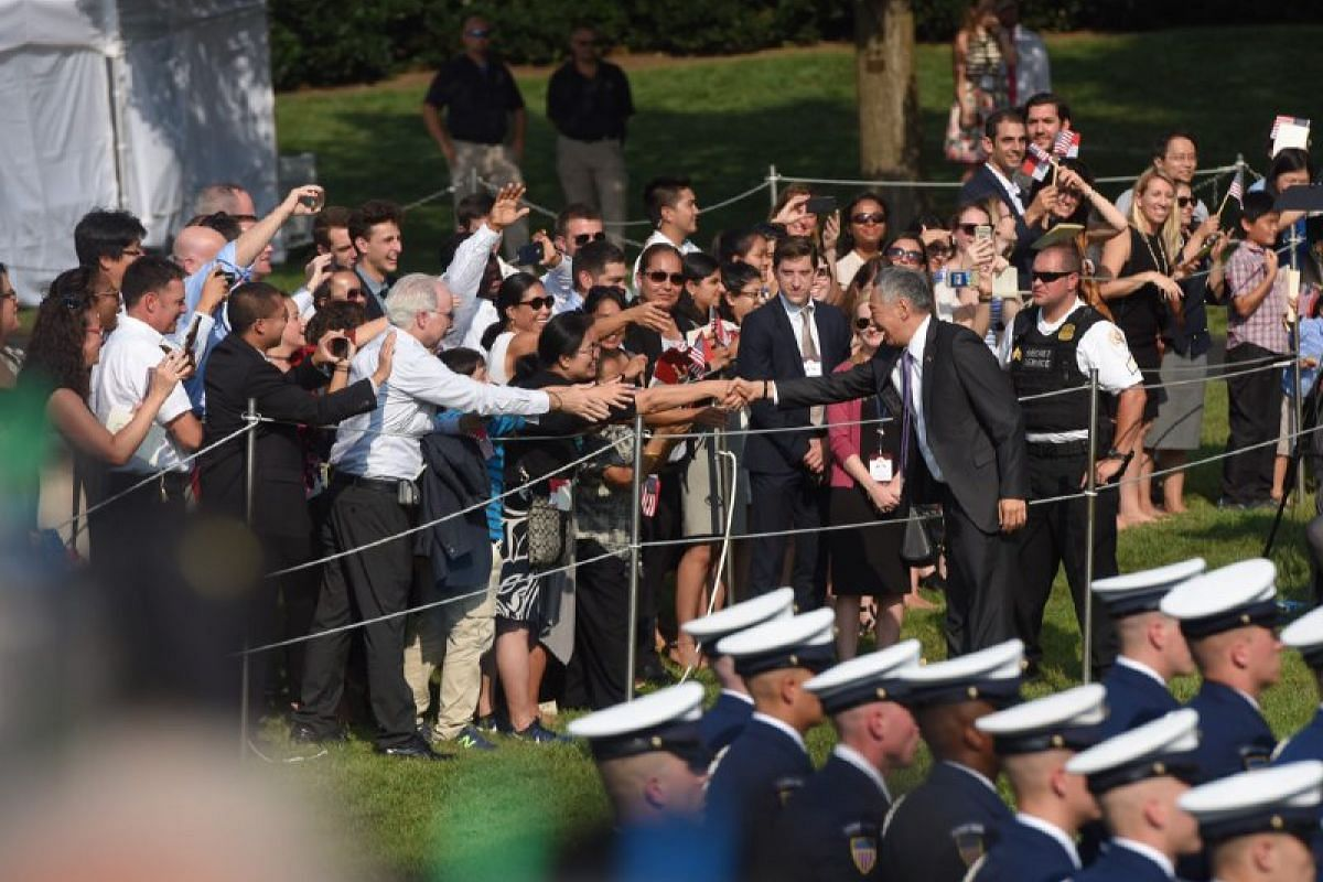 Prime Minister Lee Hsien Loong greets supporters during an arrival ceremony at the White House in Washington, US, on August 2.