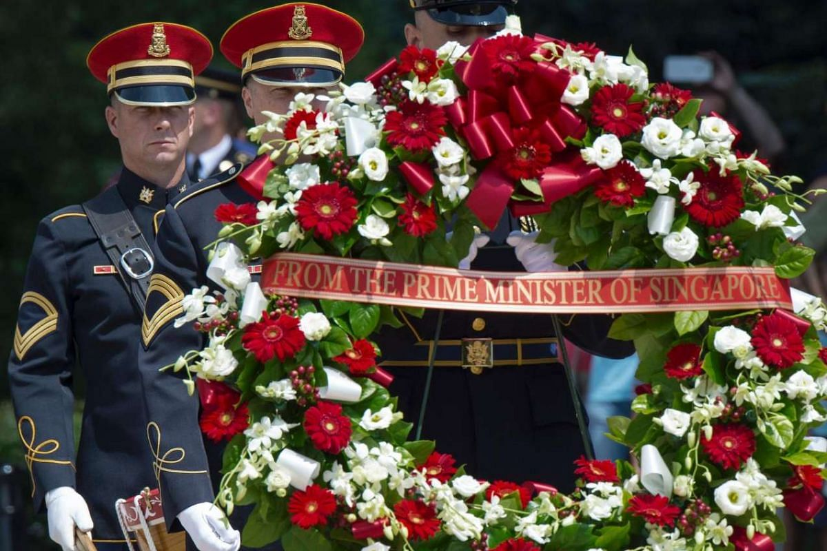 Members of the US Military Honour Guard carry out the wreath that Singapore PM Lee Hsien Loong will place at the Tomb of the Unknown Soldier August 1 at Arlington National Cemetery in Arlington, Virginia.
