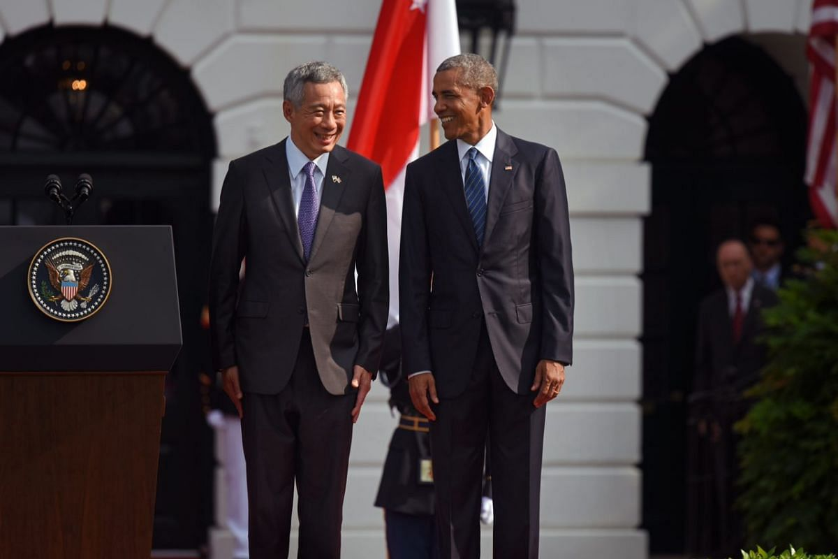 Prime Minister Lee Hsien Loong and US President Barack Obama smile during the State Arrival ceremony on the South Lawn of the White House in Washington, DC, Aug 2, 2016.