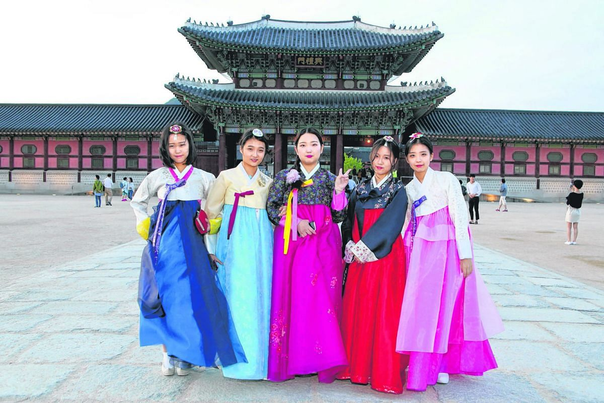 Visitors to the 14th century Gyeongbok Palace get free entry if they are wearing a hanbok. Seventeen-year-old Oh Sang Hee (centre) and four schoolmates, all clad in the hanbok, were spotted on their day out at the ancient palace in May. They each pai