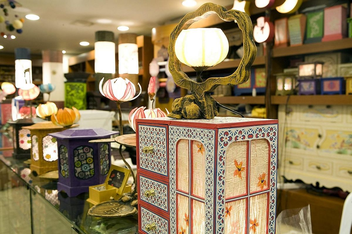 Products made of hanji, including lamps and jewellery boxes, on display in a shop in Seoul. The revival of Korean culture has resulted in many rediscovering South Korea's historical roots.