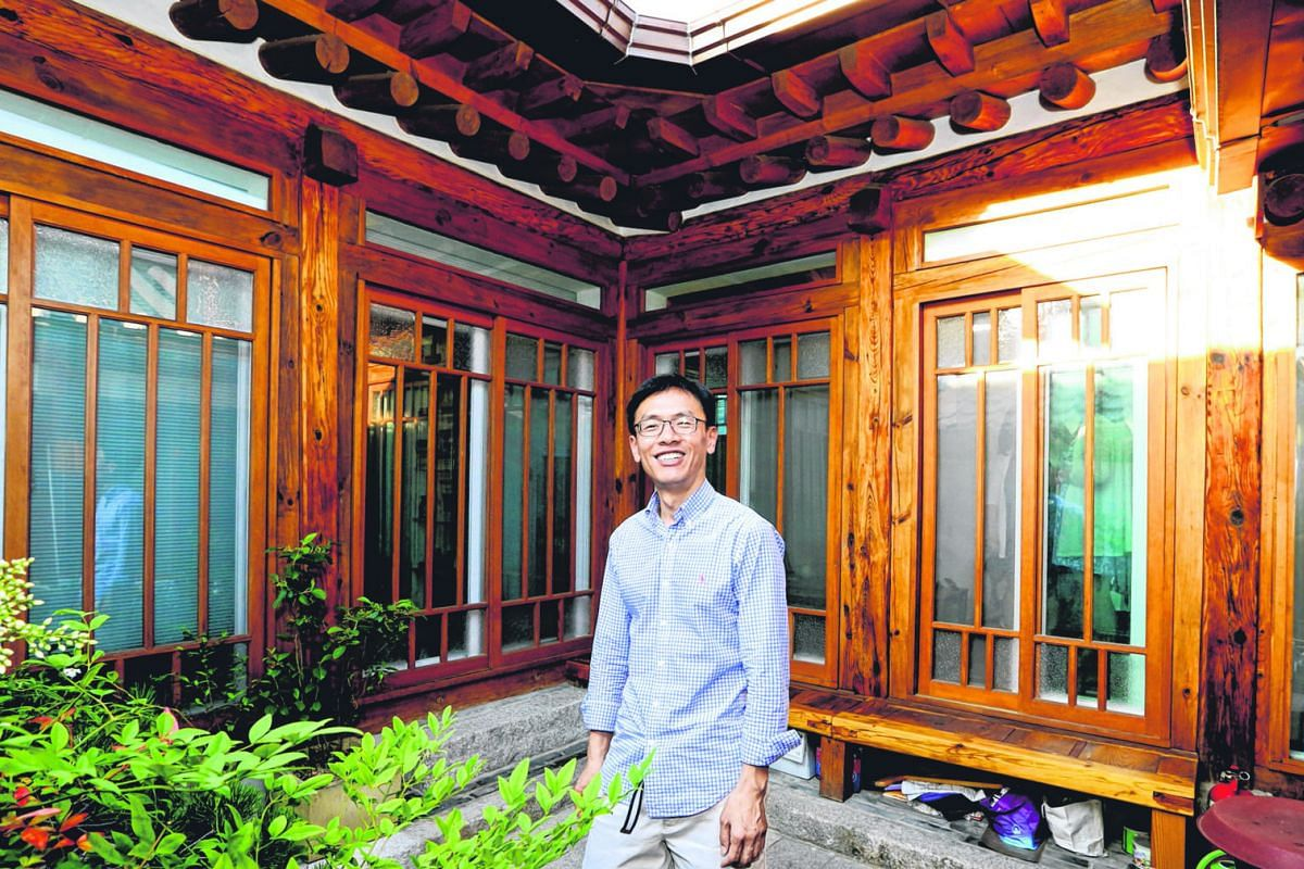 Mr Kim proudly shows off his hanok, which his parents bought in the 1980s. With the help of a government grant, he was able to give his traditional hanok a makeover which included the trappings of a modern home inside.