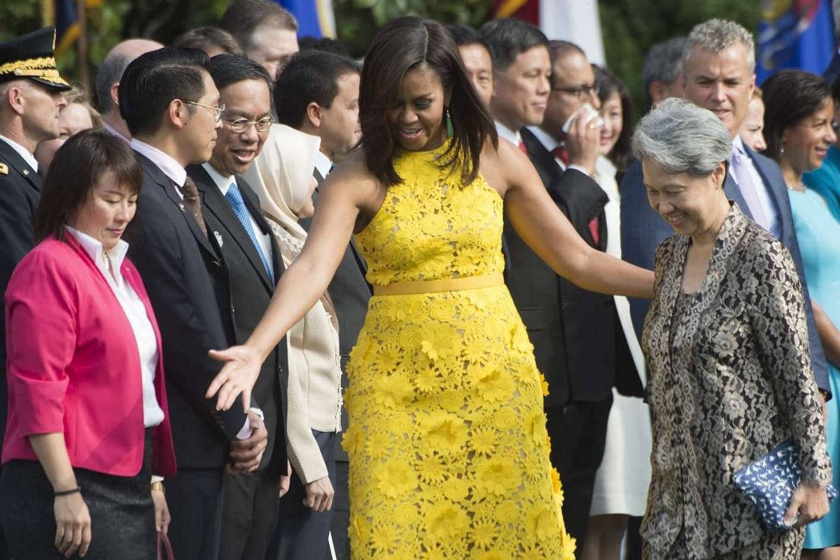 US First Lady Michelle Obama (centre) arrives with Mrs Lee Hsien Loong (right) for a State Arrival ceremony on the South Lawn of the White House in Washington, DC,  on Aug 2, 2016.