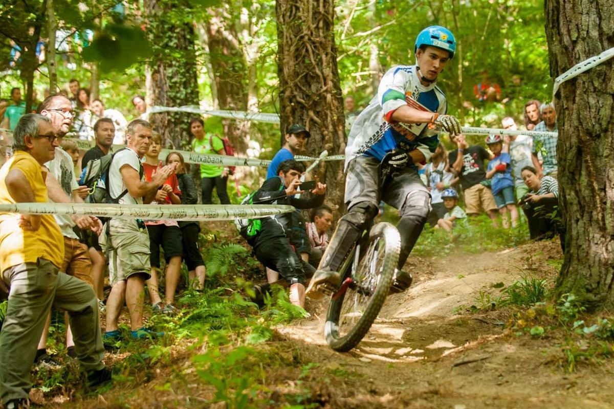Italian rider Florian Rabensteiner competes in the muni-elite downhill finals event of the 18th Unicon, (international unicycling convention) in the northern Spanish Basque village of Beasain on Aug 1.
