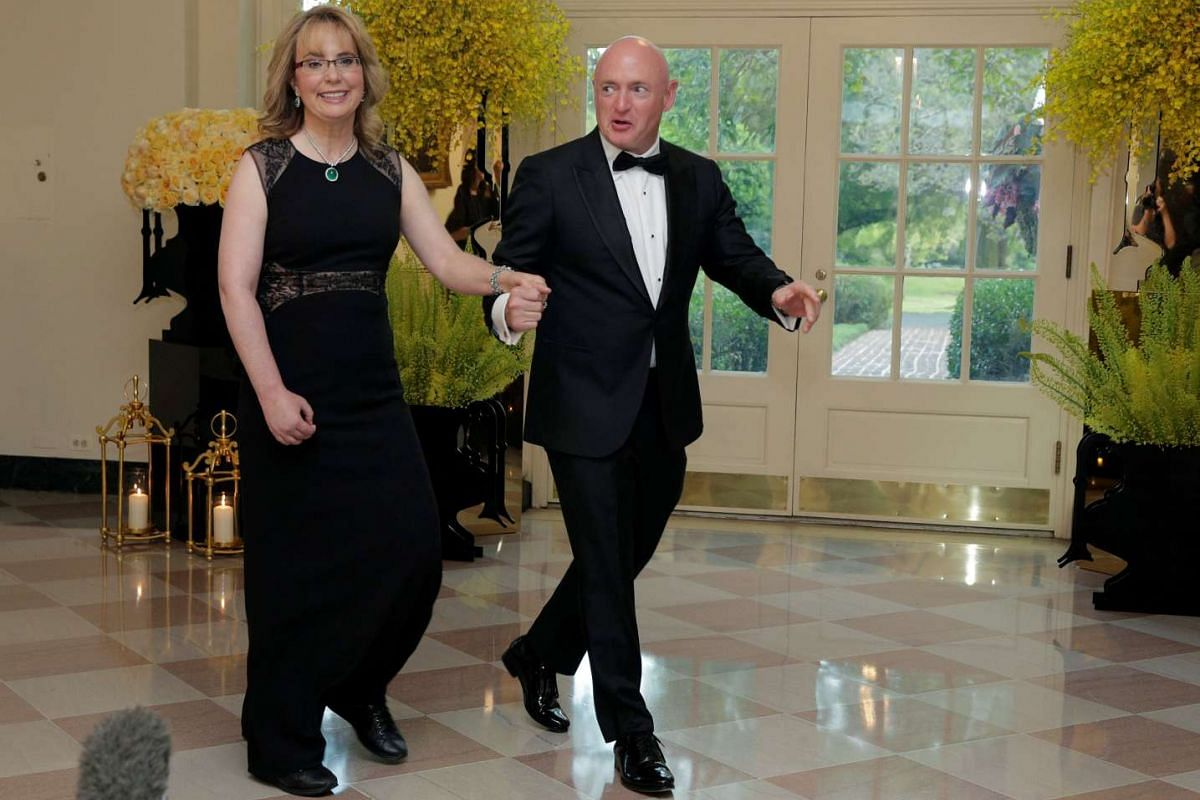 Ms Gabrielle Giffords and Captain Mark Kelly arrive for a state dinner hosted by US President Barack Obama for Singapore Prime Minister Lee Hsien Loong at the White House on Aug 2.