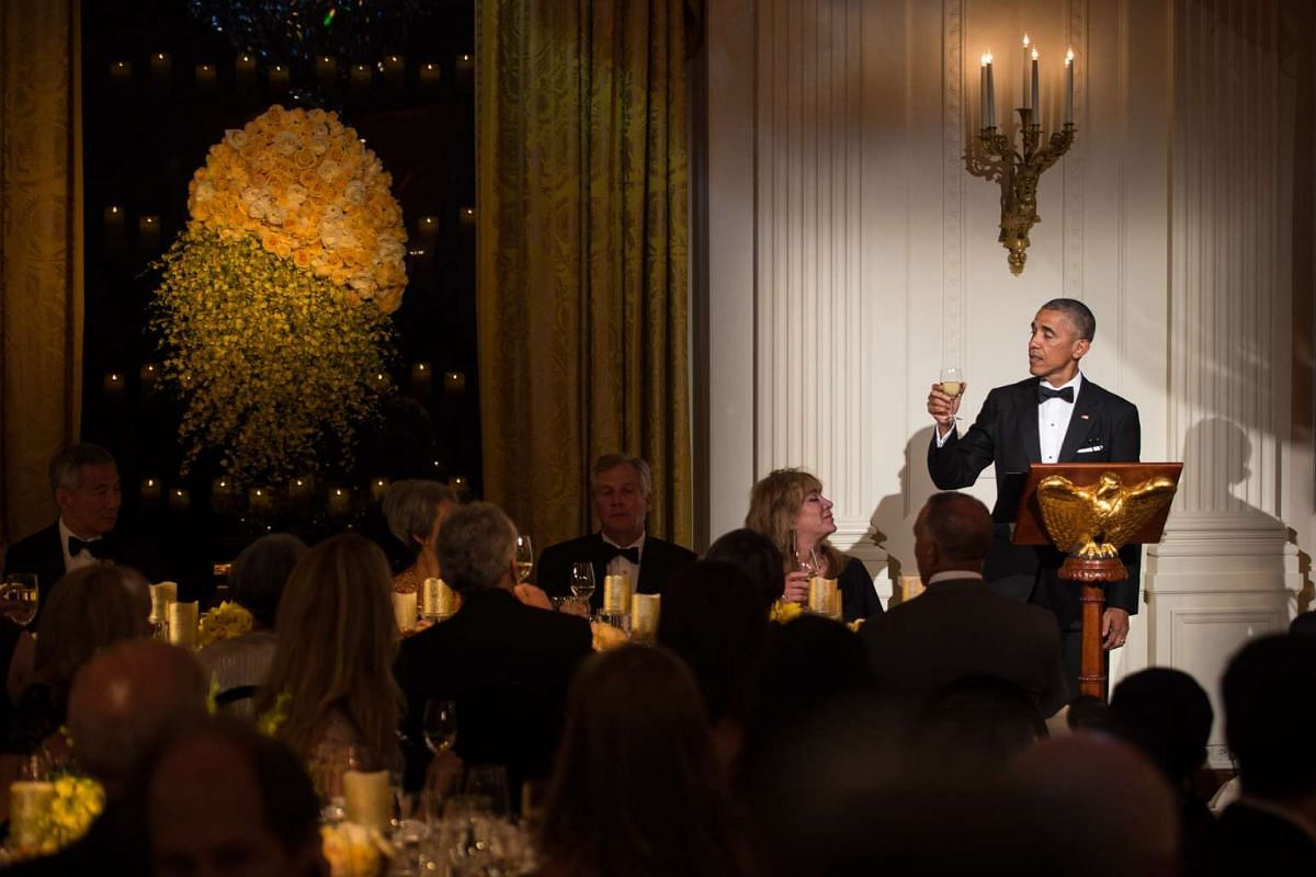 US President Barack Obama offers a toast to Singapore's Prime Minister Lee Hsien Loong and his wife Mrs Lee during a state dinner at the White House in Washington, DC on Aug 2.