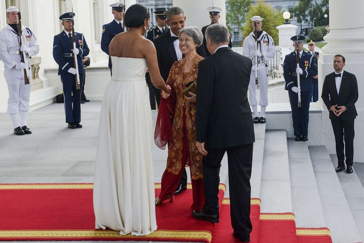 US President Barack Obama (centre back) and First Lady Michelle Obama (left) welcome Singapore Prime Minister Lee Hsien Loong (right) and Mrs Lee (2nd right) at the North Portico of the White House in Washington, DC, on Aug 2, 2016.