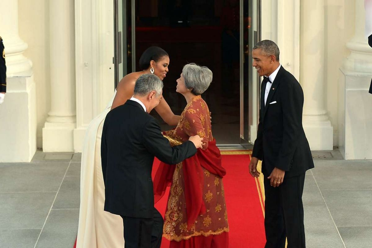 Mrs Obama greeting Mrs Lee at the entrance of the White House before the state dinner on Aug 2, 2016.