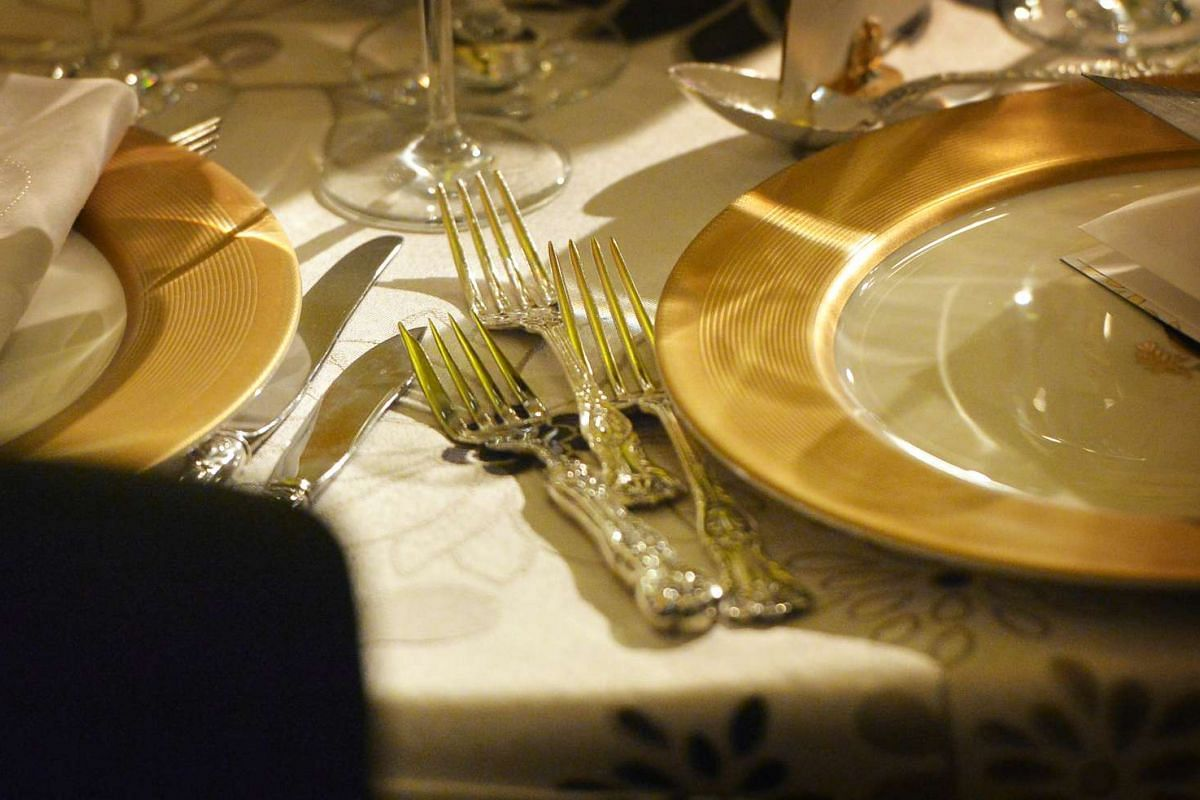 The table setting at the state dinner in the White House on Aug 2.