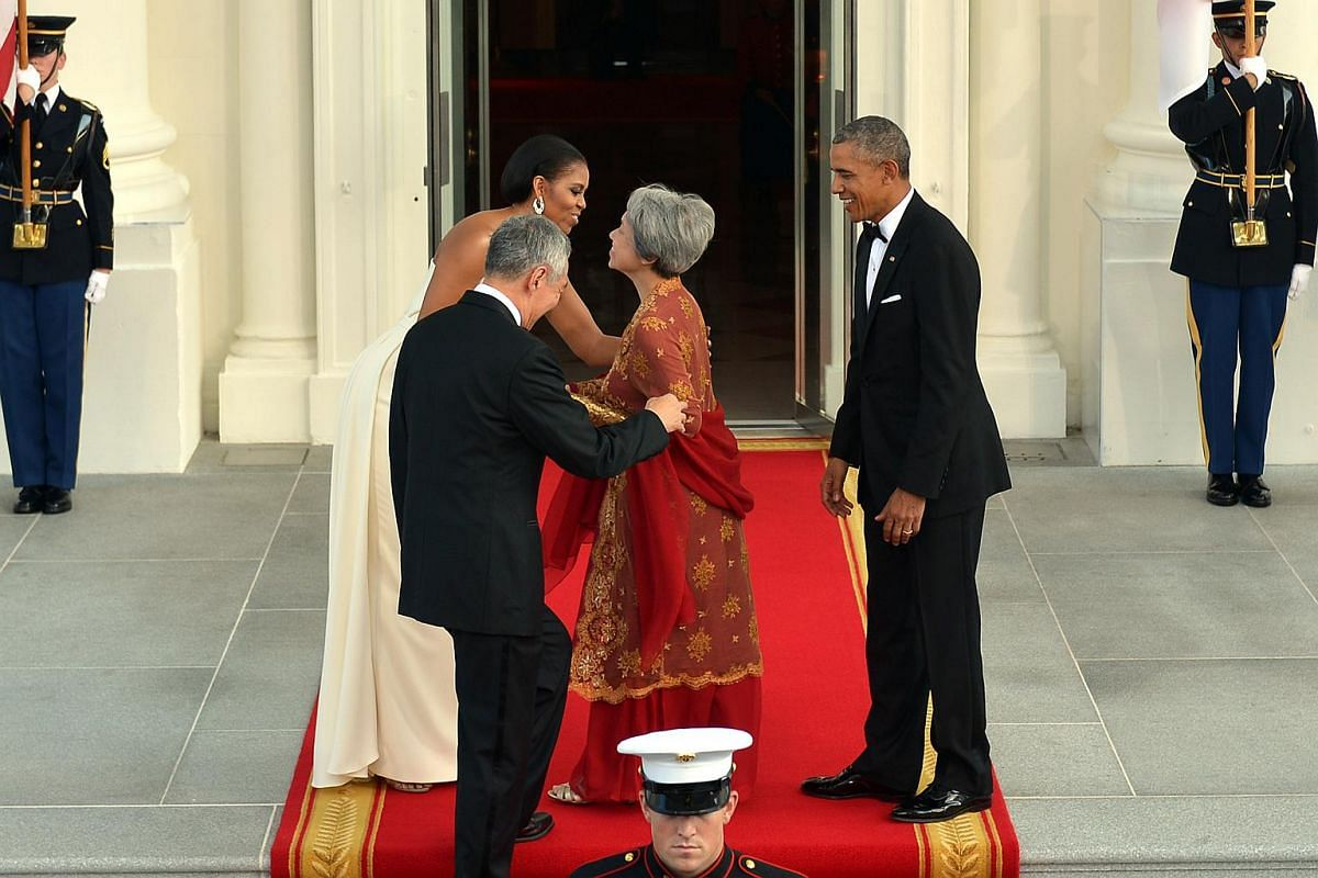 Mrs Obama greets Mrs Lee before the state dinner on Aug 2.