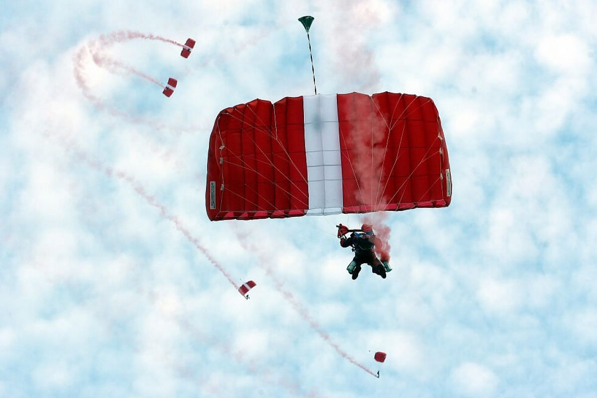 2006: One of the 15 Red Lions from the Singapore Armed Forces getting ready to land in the National Stadium after freefalling for 45 seconds at 200kmh.